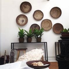 "Rustic and earthy, these authentic Makenge baskets from Zambia are wall mountable and look beautiful grouped in a collection on the wall. Also great as a table display. 48-55cm in diameter.Featuring our stunning new David Ballam Print- ""African Girl"",vintage French table chandelier and our collection of African trade beads on stands. 427, Darling Street, Balmain, 2041 Website: www.lumuinteriors.com Email: hello@lumuinteioriors.com. Phone: 0427 427 752"