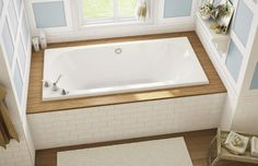 Viscount Drop-in bathtub - Keystone by MAAX 67x32x22. Nice to find a small, deep tub w center drain and corner fillers.