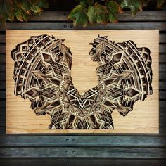 Oakland-based artist Gabriel Schama creates precisely layered wood relief sculptures that are a delight to explore. Each 1/8 inch piece of laser-cut mahoga