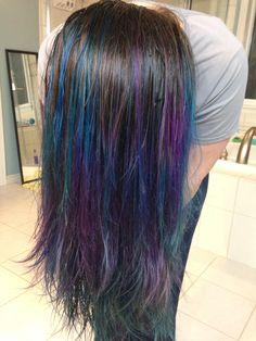 Purple and blue balayage dip dye on brunette hair.