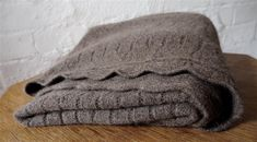 This Wyld Organic NZ Wool Lacy Blanket Throw is a gorgeous example of natural beauty. It's made from organic Pihepe wool, organic Bohepe wool, and wild possum fur. Wool Baby Blanket, Kiwiana, Warm Blankets, Consumer Products, Online Gifts, Cot, Car Seats, Silk Clothing, Boutique Shop