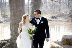 A lovely walk beside the little creek that runs into the infamous Niagara River at The Little Log Wedding Chapel for a spring elopement