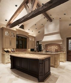 light colors with an accent island, beautiful back splash, and old rustic beams