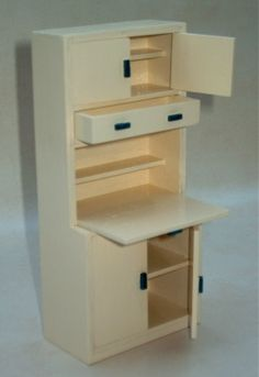 Tips: building a 1930s style cabinet, making realistic wooden blinds from a coaster, mini hinges from needles, antique radio etc. | Source: Thirties Dolls House