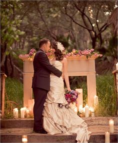 Use a fireplace mantle with simple pillar candles and coordinating flowers as a back drop for your ceremony and pictures.