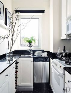 This galley kitchen was updated with a black-and-white palette | archdigest.com