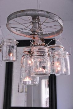 DIY Lanterns outdoor-decor.... Perhaps if I could find an old ships steering wheel or something similar and battery operated candles.....