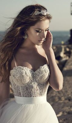 Stunning beaded and lace embroidered corset style bodice wedding dress with spaghetti straps; Featured Dress: A&J Designers