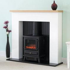 The Innsbruck White Electric Stove Fireplace Suite, – Freestanding fireplace wood burning Black Fireplace Surround, Fake Fireplace, White Fireplace, Fireplace Surrounds, Fireplace Design, Fire Surround, Fireplace Ideas, Basement Fireplace, Fireplace Facing