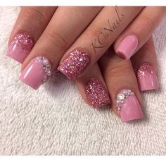 Pale pink acrylic nails. Reverse glitter fade, solid nails. Swarovski crystals and pearl accents. KCNails