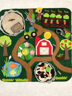 On the farm felt play mat 24x24  This mat includes: Mud, pond with fish and grass, flower skirt with seeds for chickens, barn, fences for horses