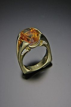 Ring by Tom Dailing in gold featuring a citrine with concave faceting by lapidary artist Richard Homer. The sparkle of diamonds adds the final touch to this beautiful ring. Jewelry Rings, Jewelery, Autumn Harvest, Victorian Jewelry, Bauble, Glitters, Beautiful Rings, Handcrafted Jewelry, Jewelry Crafts