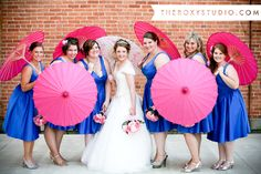 Photography by Samantha McGranahan, The Roxy Studio. Wedding photography, wedding photos, blue bridesmaid dresses, pink parasols, fun wedding props, fun photography props, princess, tiara, pink bouquet, bride