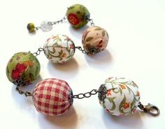 wooden beads covered with fabric, add bead cap.  cute!