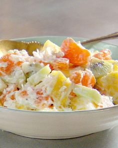 Modern Ambrosia Salad3 mandarin oranges, peeled and sectioned, sections cut in half crosswise (1 cup) 1/2 fresh pineapple, cut in chunks (2 cups) 3 kiwis, peeled, quartered lengthwise and sliced crosswise (1 cup) 1 cup sweetened coconut, plus some for garnish 1 cup plain, thick Greek yogurt 1 tablespoon honey 1/2 teaspoon vanillaSTEP 1 Place orange sections, pineapple, kiwi, and coconut in a bowl. Toss to combine. STEP 2 Whisk together the yogurt, honey, and vanilla. Fold into the f...