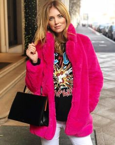 Chiara Ferragni wears a black AC/DC print sweatshirt by Gucci and a pink coat by Majorelle