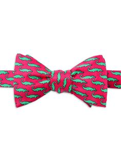 The whimsical illustration makes the 100% silk bow tie perfect for a day at the office or a night out on the town. Neck size: 14 inches to 16 inches.
