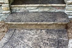 Seamless Stamped Concrete sidewalk with hand tooled border and porch/step with 2 inch rough granite overhang - sandstone Davis integral color with storm gray antiquing release agent. By The Concrete Artisans, Inc.