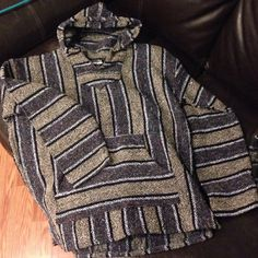 New!✌️hippy poncho surfer Trendsetters only!✌️ Grey with color speckles, Beige, black and white stripes. Authentic from Mexico. Never worn never washed, brand new without tags. Bought in Mexico last year. Tag is XL, fits like Womans XL or a Men's Large. NO TRADES Sweaters