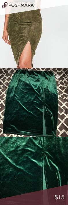 Dark Green Skirt w/ Split This is a dark green skirt that has a split in the front just like the photo above. This item is new with tags. Has never been worn before. Charlotte Russe Skirts Pencil