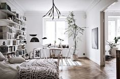 Bedroom and work space in a lovely Swedish space in white and wood (with lots of plants)