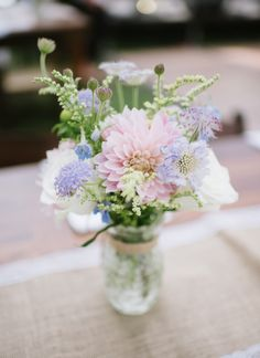 Pretty pastel table flowers: http://www.stylemepretty.com/colorado-weddings/steamboat-springs-colorado/2016/01/26/elegant-rustic-colorado-wedding/ | Photography: Andy Barnhart - http://www.andybarnhart.com/