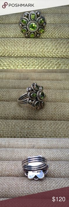 Sterling Silver Peridot Gemstone Ring. Stunning! New Sterling Silver Peridot Ring, 6 marquise peridot stones with one large center peridot stone. Sterling silver ring band is thick. Stamped 925. Size 7.5. Never worn. New. No retail tags. Jewelry Rings