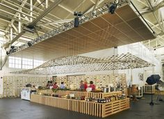 walls made of pickle jars and a ceiling composed of 3,000 mason jar lids suspended from wires