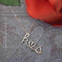 Custom Sterling Silver Lovers Initial Pendant. $39.99, via Etsy.