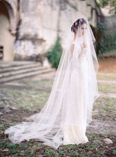 Bride with floral crown and cathedral veil. See more stunning veil trends here: http://www.mywedding.com/articles/9-veils-for-every-type-of-bride/