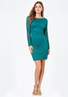 Office-party dress in a flirty lace design finished with tonal threadwork that subtly enhances curves. Long sleeves. Back hook-and-eye and exposed zip closure. Partially lined.