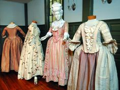 Examples from the Newport Historical Society's apparel collection include a Quaker woman's dress at far left and a striped silk taffeta dres...