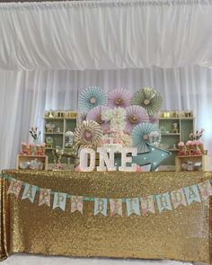Glittery carousel first birthday party! See more party ideas at CatchMyParty.com!