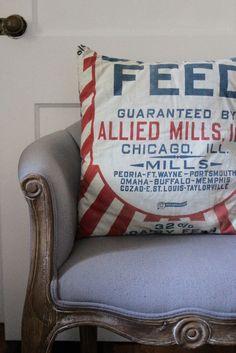 Vintage feed sack turned into a pillow for a bohemian farmhouse decor!
