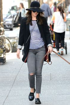 Dakota Johnson wearing Mother Looker Ankle Fray Skinny Jean in Last Chance Saloon and Chanel Wallet on Chain Walking Her Dog on April 13, 2015.