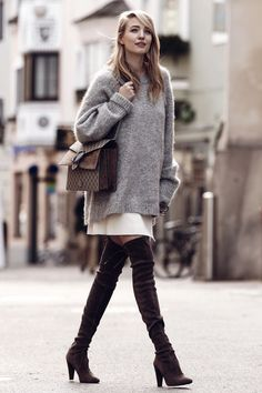 Try wearing an oversized knit sweater with a pale or pastel coloured skirt and overknee boots