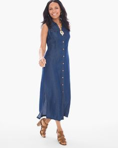 "When it comes to a look of everyday elegance, this shirt dress fits the bill. Designed in a gorgeous chambray shade, it's finished with chest pockets and bronze-tone buttons for a dash of chic contrast.  Button closure.  Chest pockets.  Regular length: 50"".   Petite length: 47"".   Tencel®.  Machine wash. Imported."
