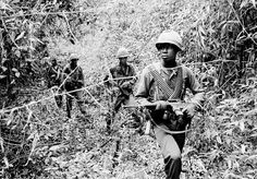 U.S. soldiers are on the search for Viet Cong hideouts in a swampy jungle creek bed, June 6, 1965, at Chutes de Trian, some 40 miles northeast of Saigon, South Vietnam. (AP Photo/Horst Faas)