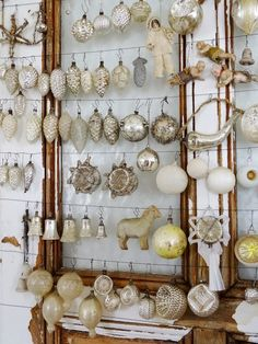 Vintage Christmas Ornaments - strung from wire across a salvaged door frame - via Princess Green Eye