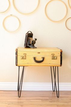 Vintage suitcase side table. It looks like it's smiling at me.