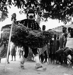 Africa | A We masquerader dances in a village near Duékoué, Moyen-Cavally region, Ivory Coast | 1963 | Photographer André P Schaller
