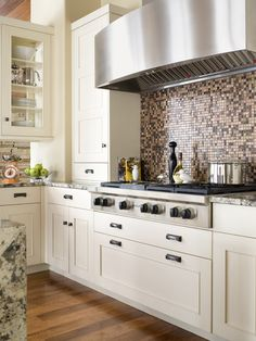 Castle Pines kitchen with beautifully clean lines and gorgeous backsplash.