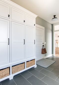 Grey and Blue Mudroom Blue and gray mudroom. Blue slate tile, white lockers and baskets in this lake house mudroom. Grey and Blue Mudroom Blue and gray mudroom. Blue slate tile, white lockers and baskets in this lake house mudroom. Mudroom Cabinets, Mudroom Laundry Room, Mud Room Lockers, Line Design, Design Design, Home Renovation, Home Remodeling, Basement Renovations, Gray Painted Walls