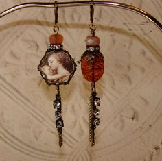 Mother Mary and Christ Asymmetrical Picasso Earrings. $35.00, via Etsy.