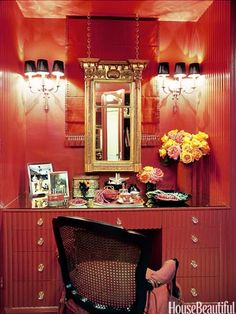 Walk-In Closet: Paint it a glossy color, hang a mirror and sconces, add a vanity, and voilà: a glamorous little dressing room!