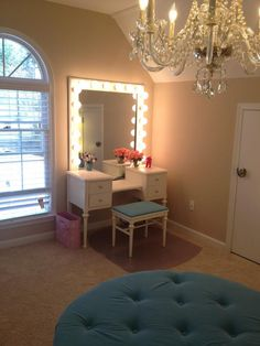 spare bedroom / dressing room... Love the idea of a chandelier and fresh modern/pretty colour in a small room