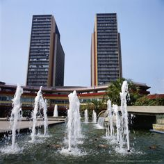 Venezuela, Caracas, Simon Bolivar Center, Fountains in front of skyscrapers.