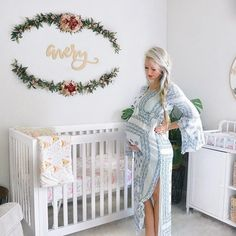 We're ignoring the fact that it's Monday morning and we still have a boatload of Valentines to assemble, but instead staring at this dreamy nursery and beautiful mama. (Image via @janenecrossley)