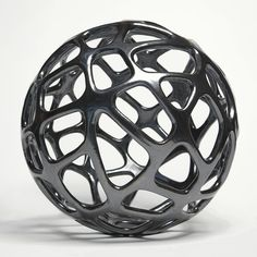 cellular sphere [Pamela Sunday makes ceramic sculptures inspired by nature and science.]