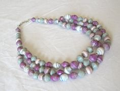 African recycled paper necklace in purple by embirajewellery, £18.00